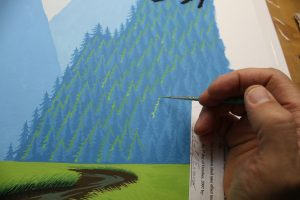Painting Trees On A Gouache Painting Of A Curlew - Using a liner and water based gouache paint, I am painting the sun highlights on the trees.