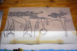 This is a tracing of our original drawing hinged at the top of our painting, flipped over. You can see carboned portions of the tracing paper of the painting that is now complete.