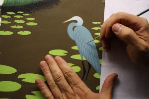 Painting over the pencil lines drawn for the feathers.