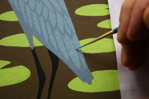 A close-up of me painting the pencil feather lines with my Windsor & Newton Regency Gold 540.